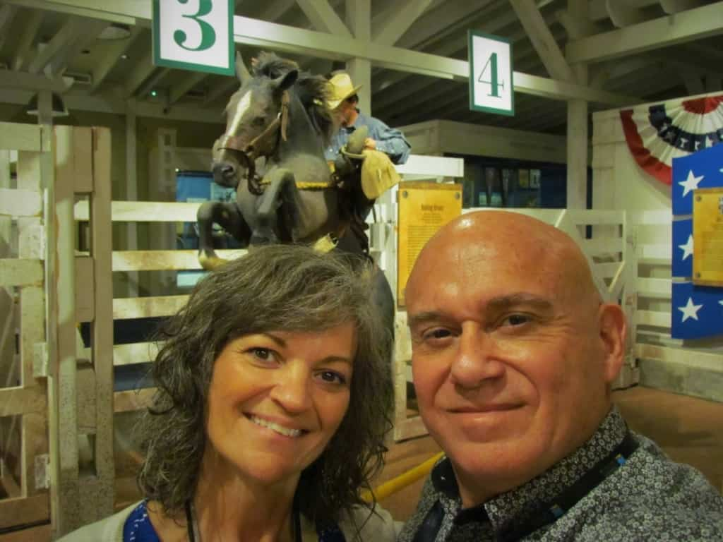 "The authors pose for a selfie at one of the predetermined ""Selfie Spots"" that are found throughout the National Cowboy Museum."