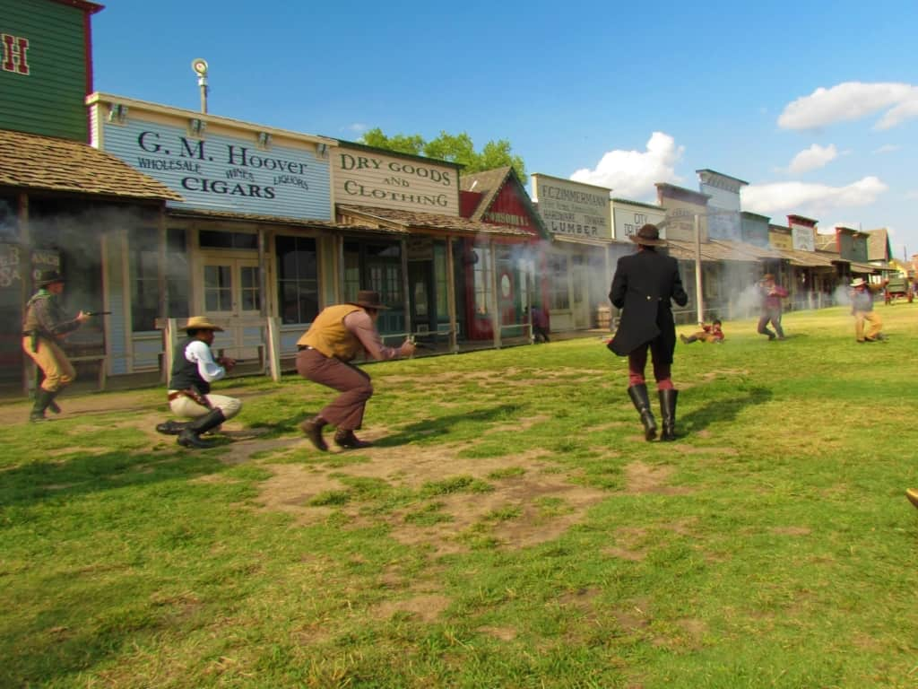 Guns blaze and actors drop as they recreate a gunfight at Boot Hill in Dodge City, Kansas.