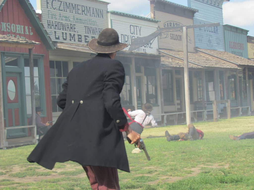 The Marshall is the last person standing after a large scale gunfight.