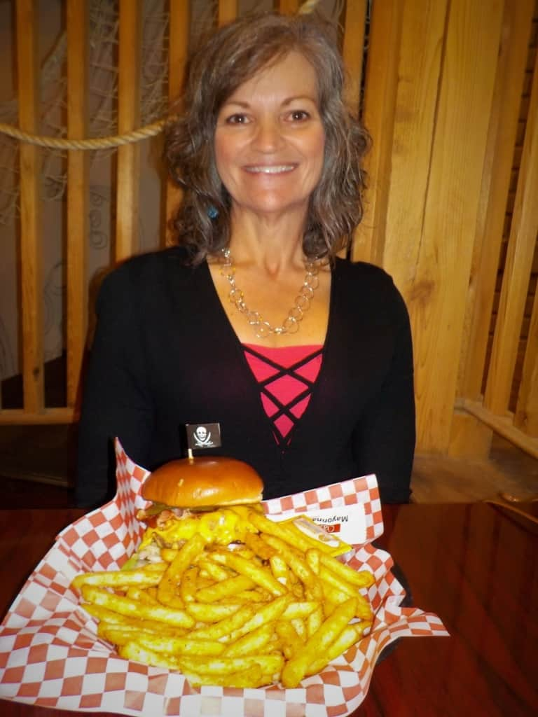 Crystal poses with her massive burger and fries from Pirate Pete's in Parkville, Missouri.