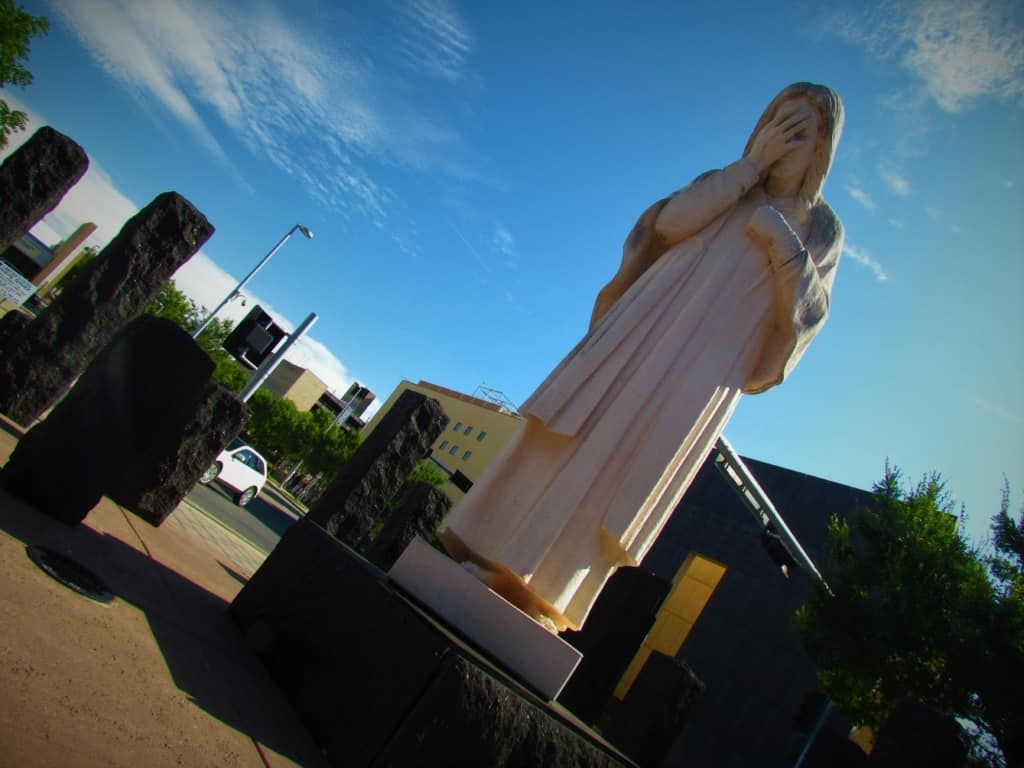 """The """"Jesus Wept"""" statue sits just outside the grounds of the Oklahoma City Memorial and Museum."""