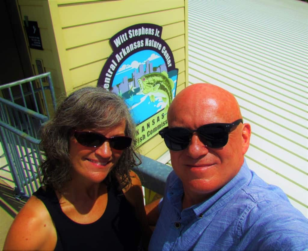 The authors pose in front of the Nature Center entrance.