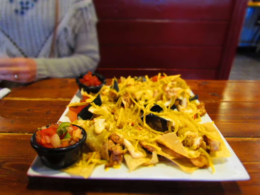 Grilled Chicken Nachos can be dressed up as much or as little as you like.