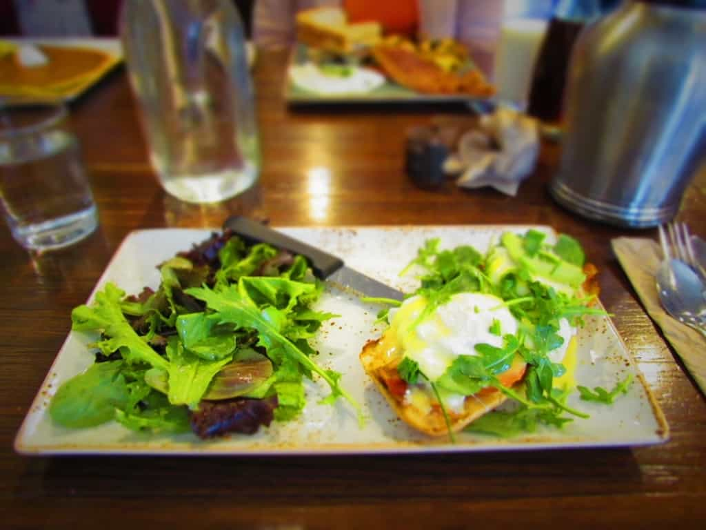 The BLT Benedict is a mix of flavors and comes with a side of mixed greens.