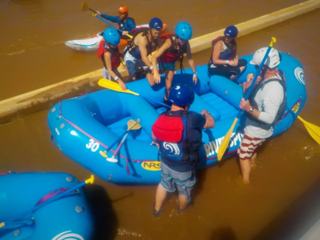 A group scrambles into their raft.