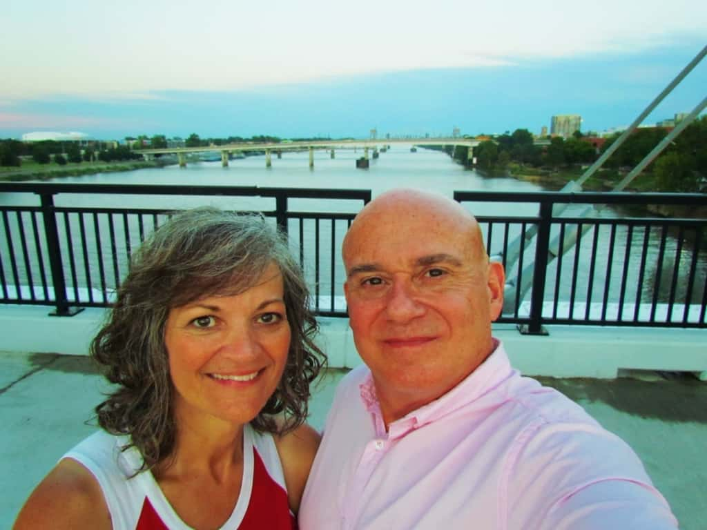 The authors pose for a selfie on one of the pedestrian bridges along the Arkansas River in Little Rock, Arkansas.