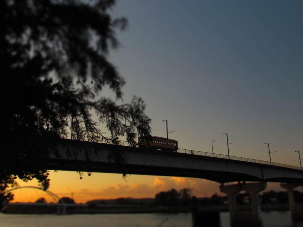 A streetcar crosses the Arkansas River in Little Rock,.