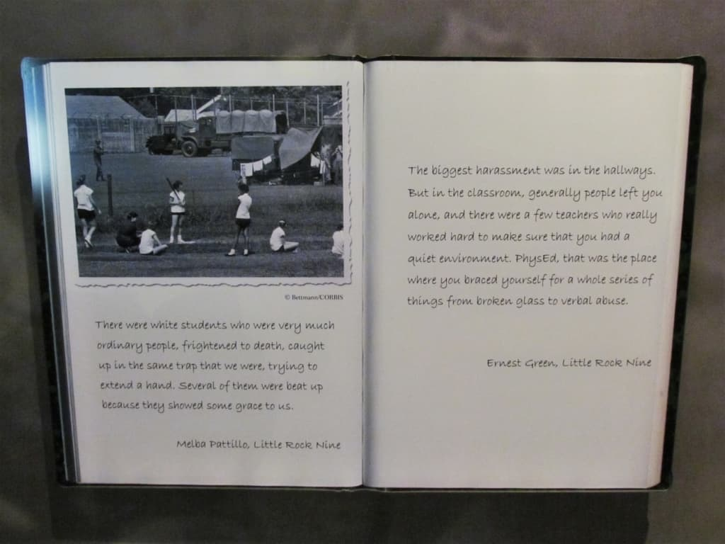 Pages from a book relate the experiences of two of the Little Rock Nine.