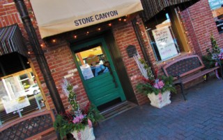 The awning at Stone Canyon Pizza signals that you have arrived at a Parkville landmark.