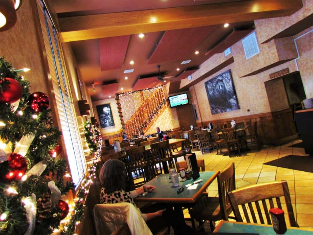 Crystal checks out the holiday decorations during a visit to Stone Canyon Pizza.