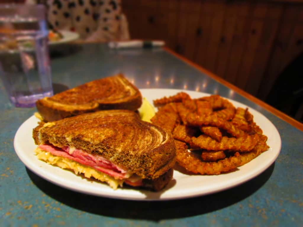 The Reuben Sandwich, at Stone Canyon Pizza, can be paired with Sweet Potato Fries for a filling lunch option.