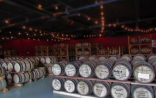 The oak barrels hold a variety of products produced at Rock Town Distillery.