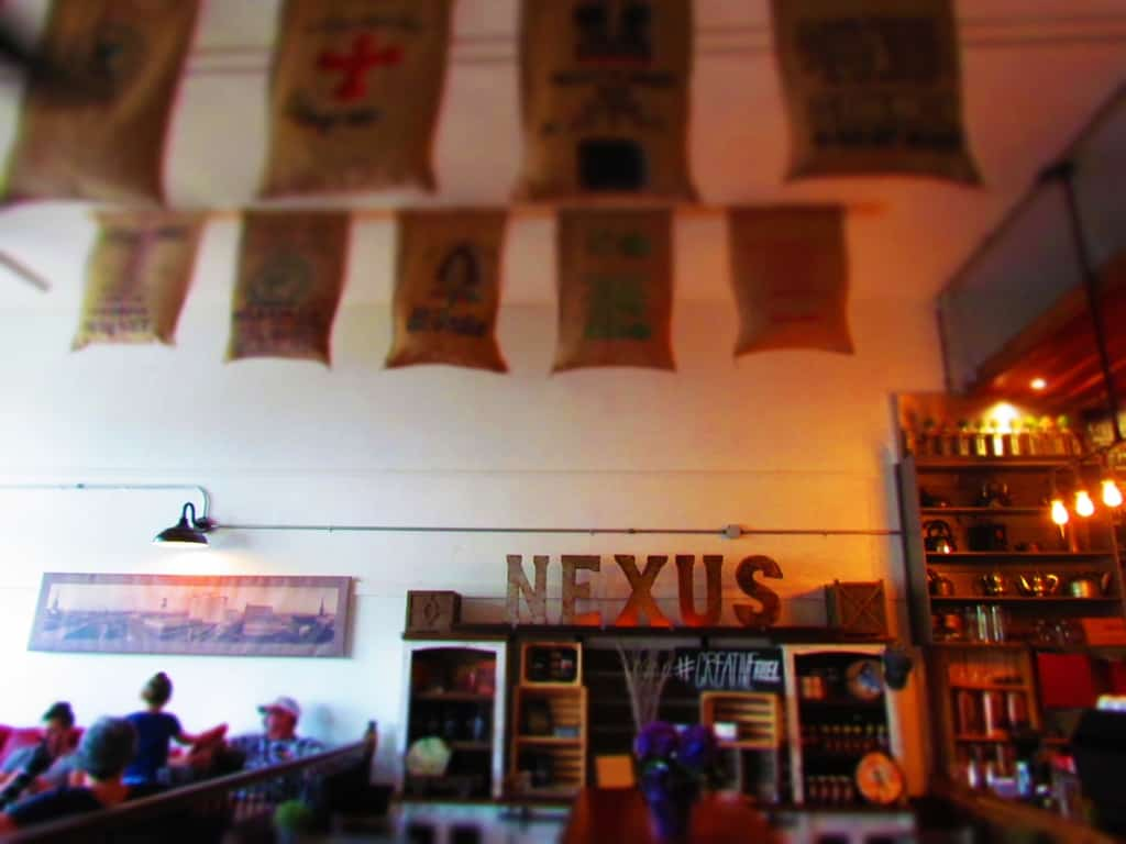 The interior of Nexus Coffee is decorated with coffee sacks.