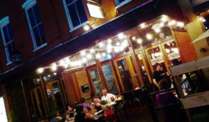 The exterior of Stock & Barrel includes outdoor patio seating in downtown Knoxville.