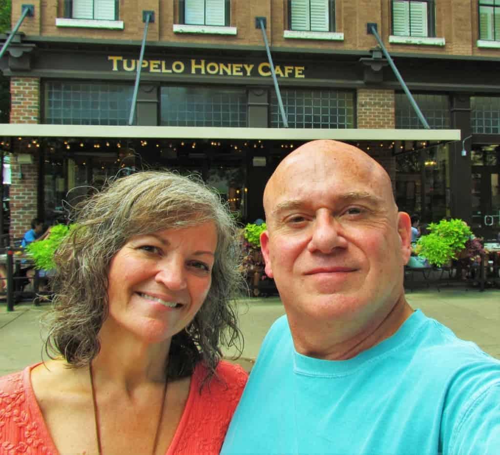 The authors pose for a selfie outside of Tupelo Honey Cafe in downtown Knoxville, Tennessee.