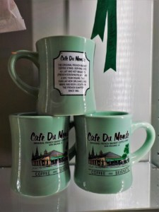 Coffee mugs denote their origin from Cafe Du Monde in New Orleans.