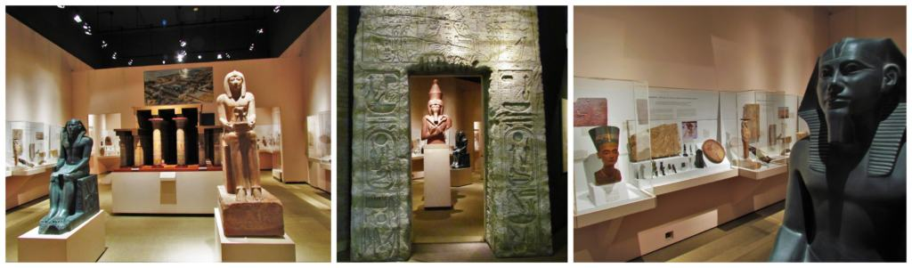 An Egyptian exhibit is packed with sculptures, carved reliefs, and various artifacts.