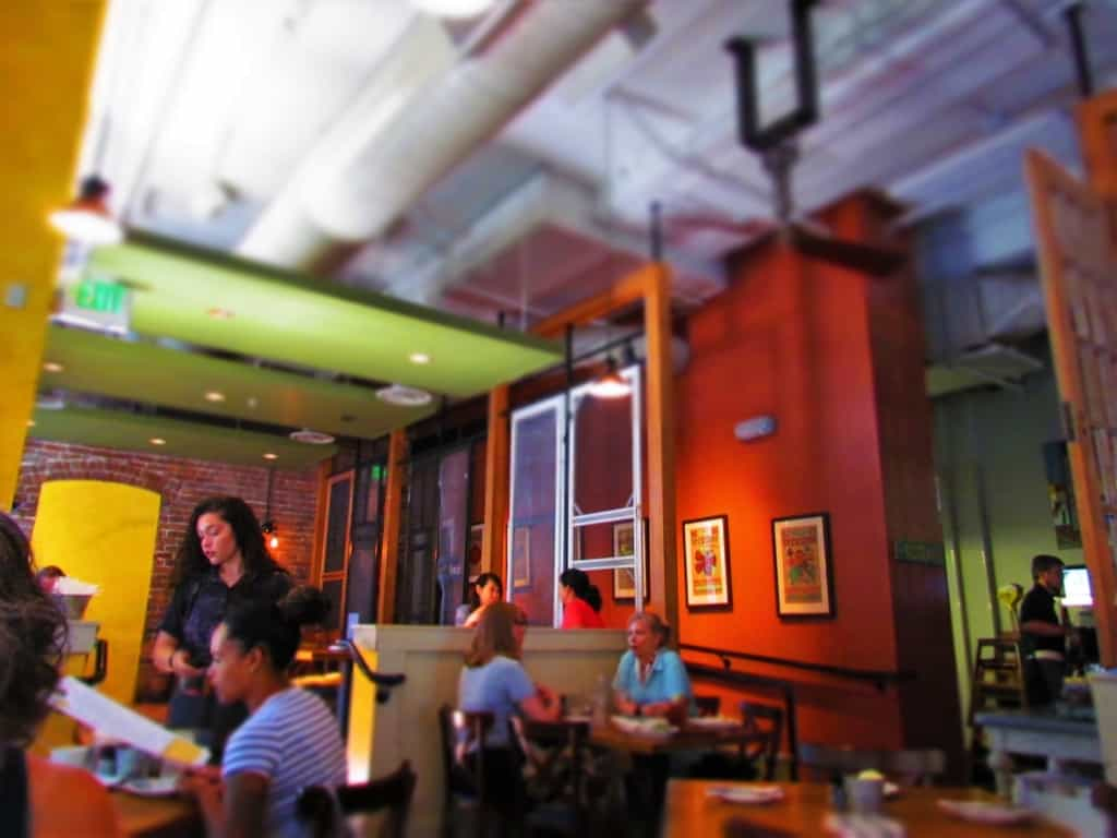 The interior of Tupelo Honey cafe is a relaxing atmosphere for southern style dining.