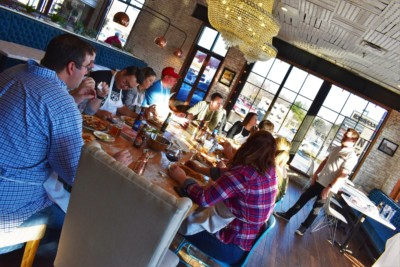 A group of friends enjoy the pizzas that they made during a class at 1889 Pizza Napoletana.