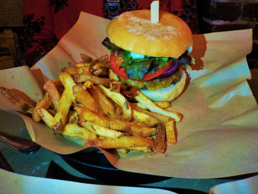"""The """"Merican Burger has all the toppings one would expect at a cookout in the backyard."""