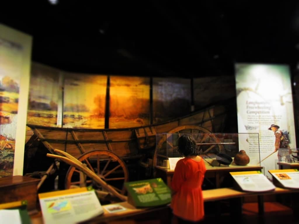 The author examines the information displayed about an exhibit on early pioneers.
