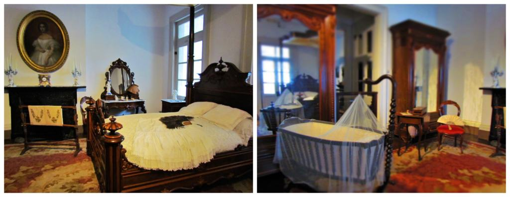 A Victorian bedroom is filled with luxurious pieces of furniture including an ornate bed.