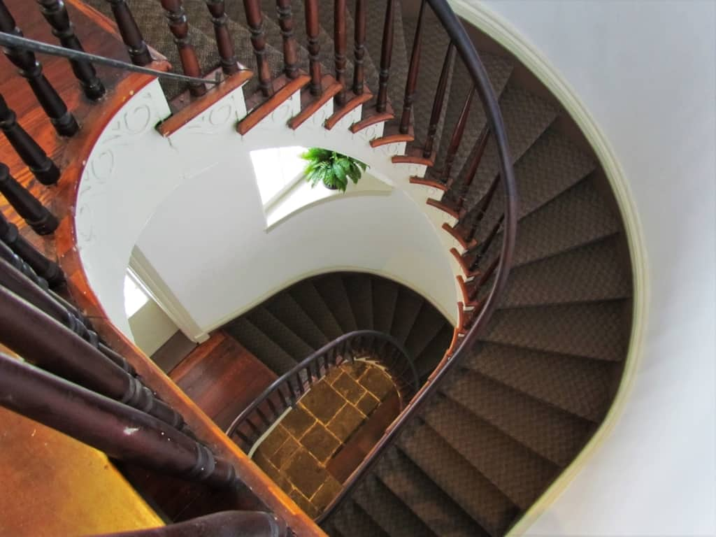 A beautifully designed circular staircase serves an important purpose without taking up too much floor space.