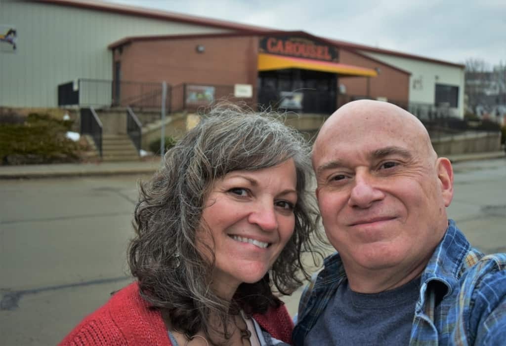 The authors pose for selfie outside of the C. W. Parker Carousel Museum.