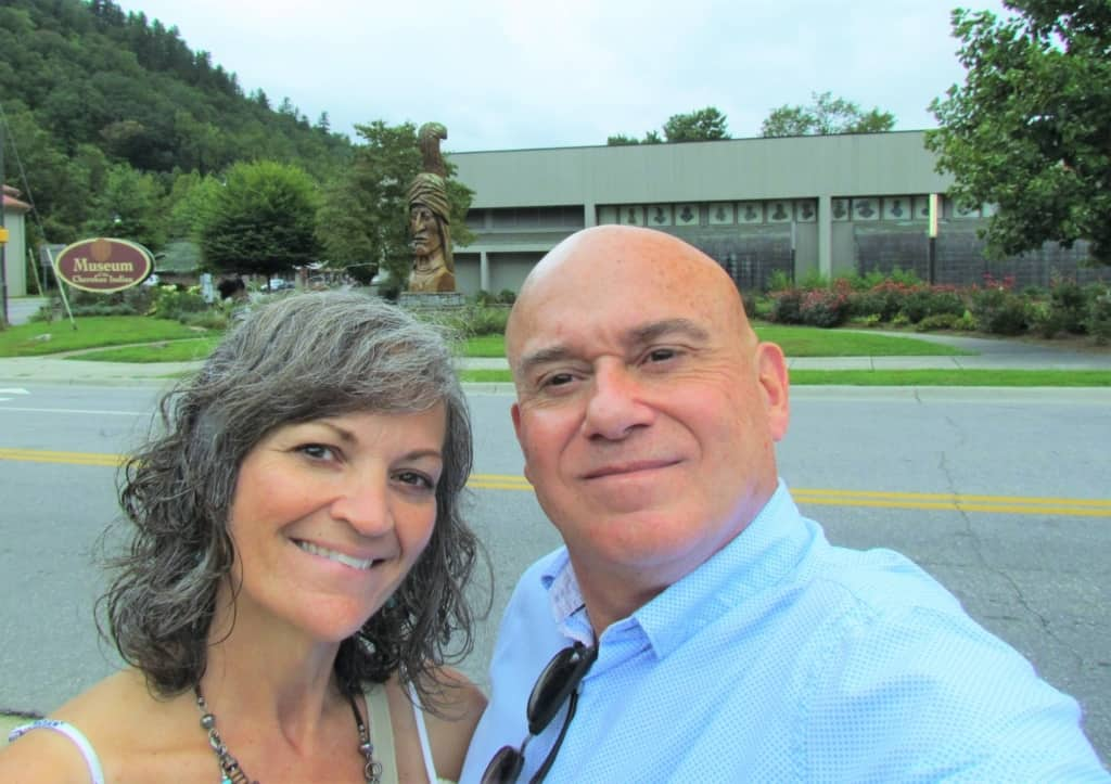 The authors pose outside of the Museum of the Cherokee Indian.