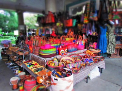 Brightly colored items are prominently displayed in the 5 blocks that make up the French Market in New Orleans.