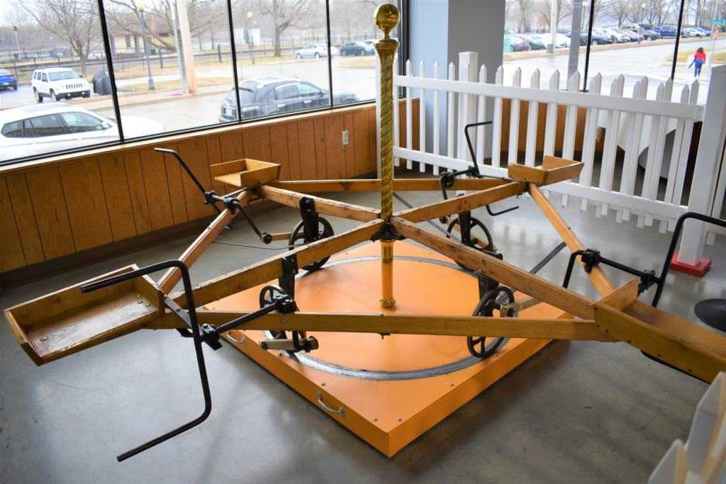 This healthy alternative to a carousel required the children to supply the power.