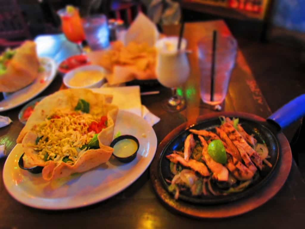 A sizzling platter of fajitas is a great addition to a salad.