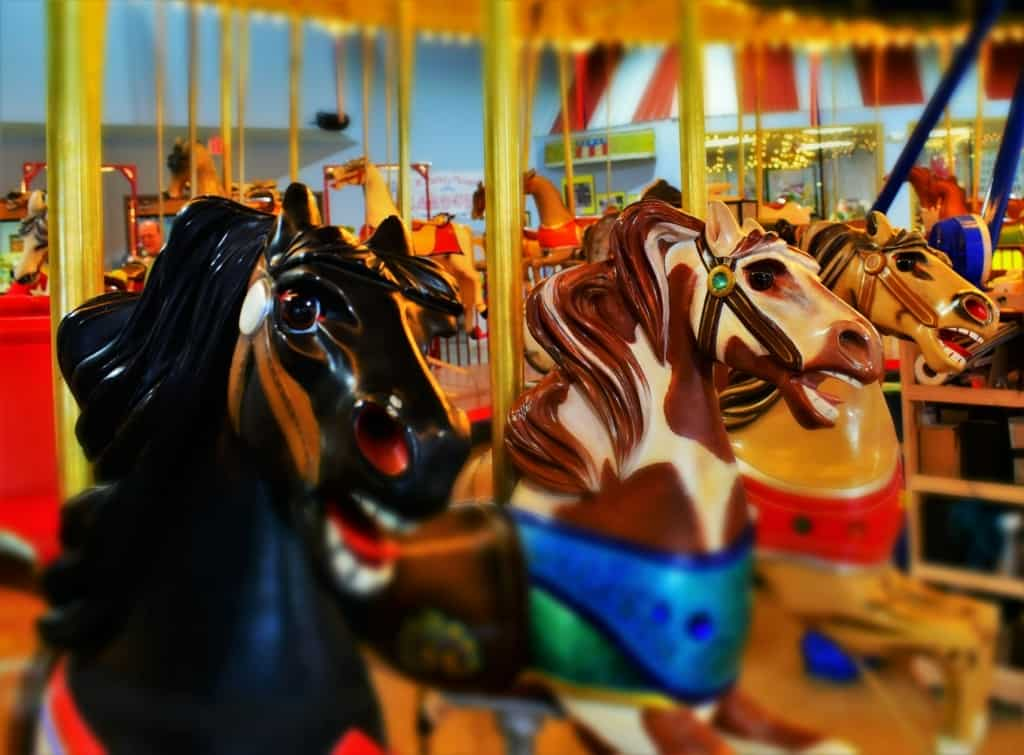 Three original Parker horses are ready to carry guests around the ring.