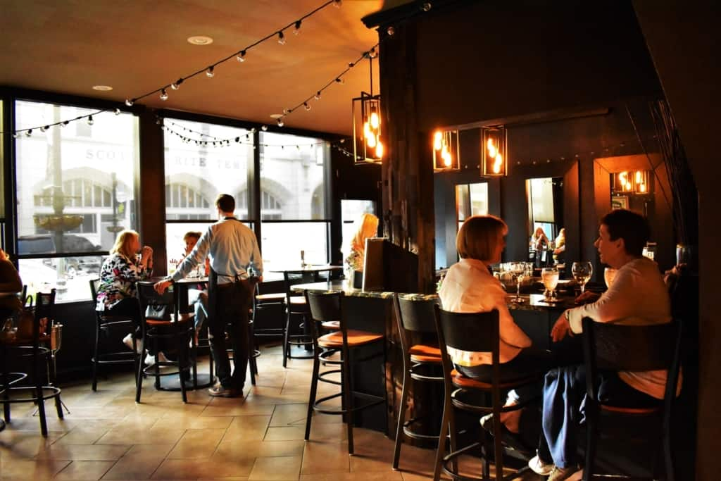 Locals enjoy a relaxing happy hour experience at Crooner's Lounge.