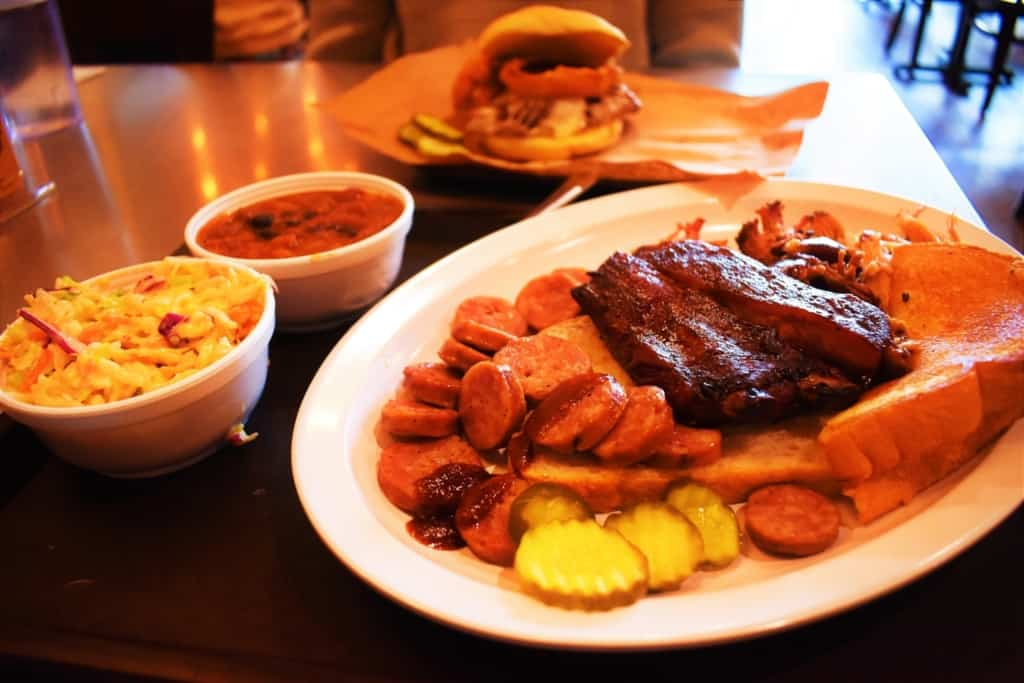 The Hogamaniac Platter sets out three meats and two sides in a feeding smorgasbord.
