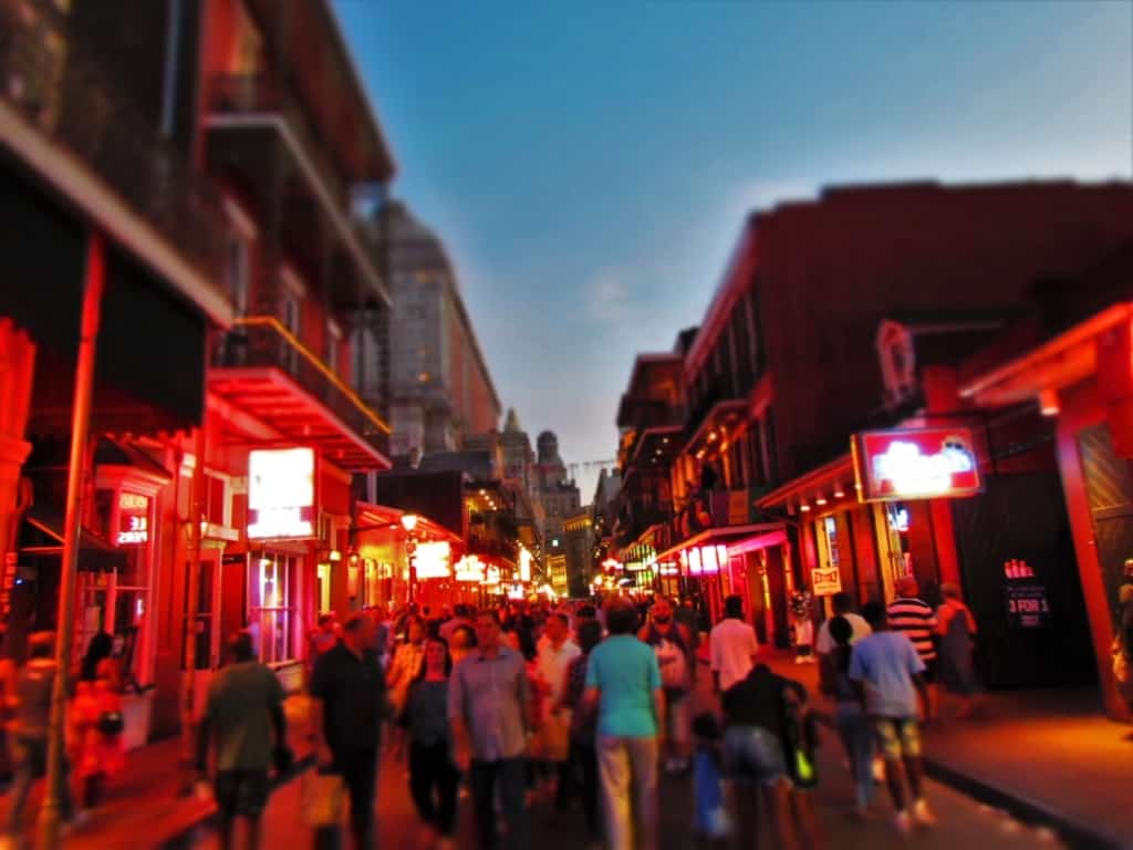 As night falls in New Orleans, the crowds begin to gather on Bourbon Street in the French Quarter.