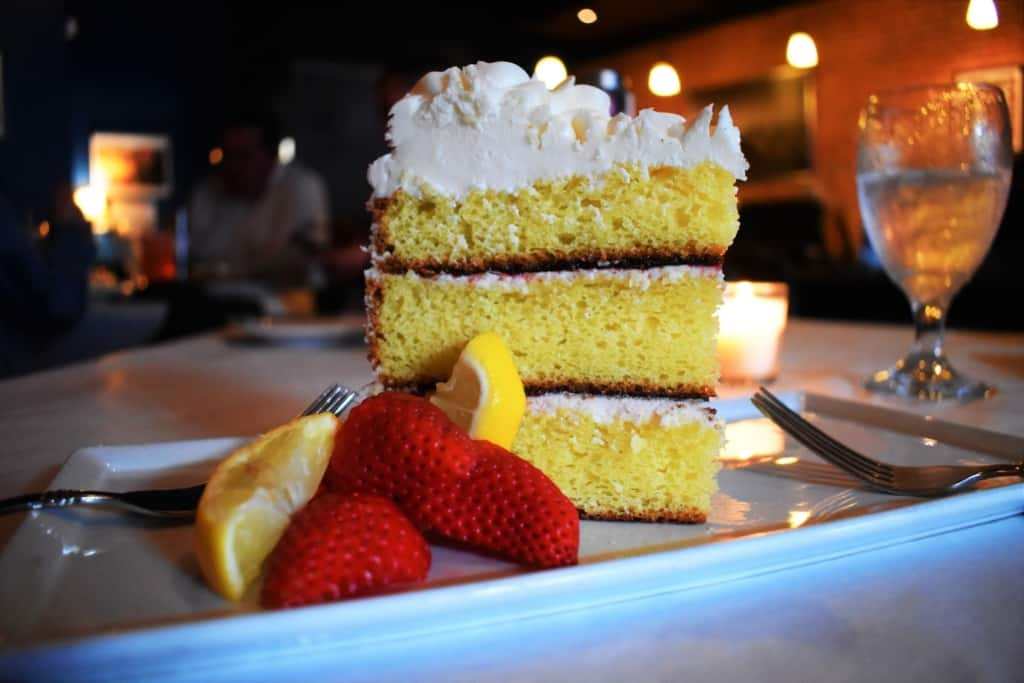 A massive slice of Lemon-Raspberry Cake is too tempting to pass up at Crooner's Lounge.