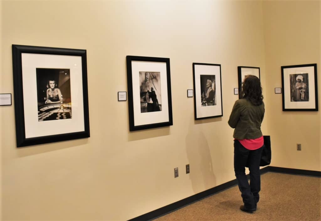Crystal examines the photos donated by Parks to the Fort Scott museum.