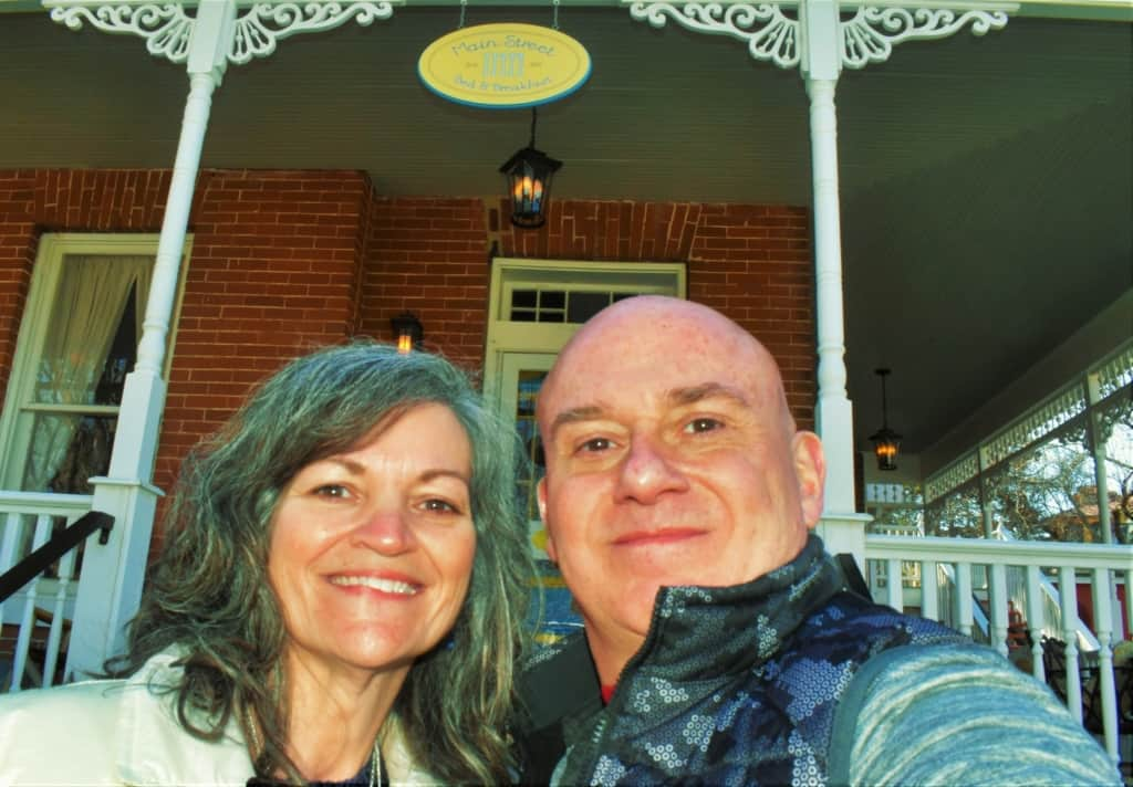 The authors pose for a selfie in front of Main Street Inn in Parkville, Missouri.