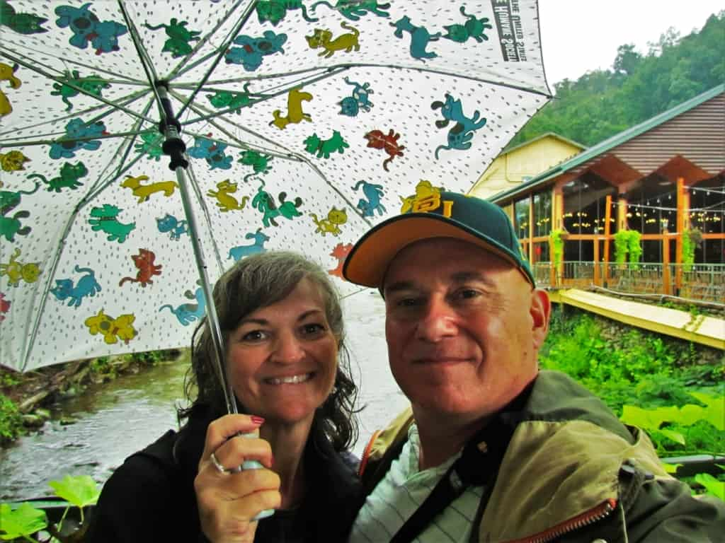 The authors stop for a quick selfie during a brief rain shower in downtown Gatlinburg, Tennessee.