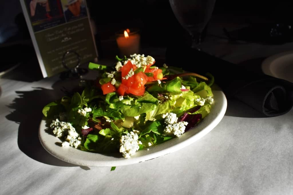 A house salad is the perfect start to an upscale dining experience.
