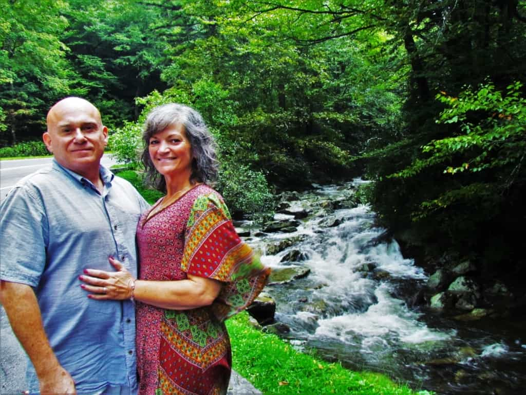 The authors pose beside a roadside stream while cruising the Blue ride Parkway.
