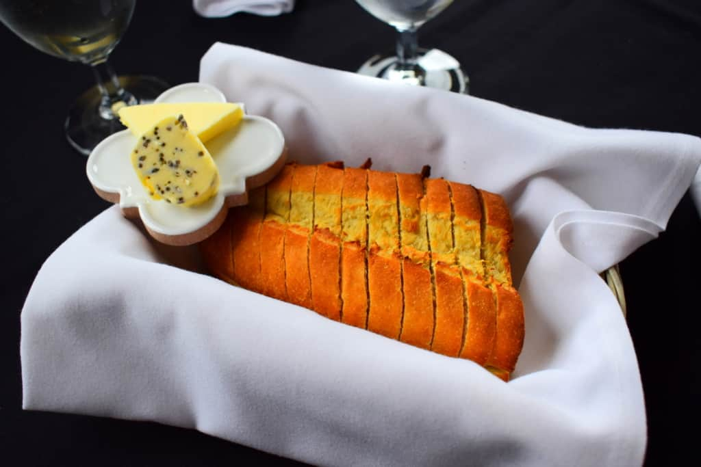 Crusty French bread is the perfect base for the Lavender Salted Butter at Cafe des Amis.