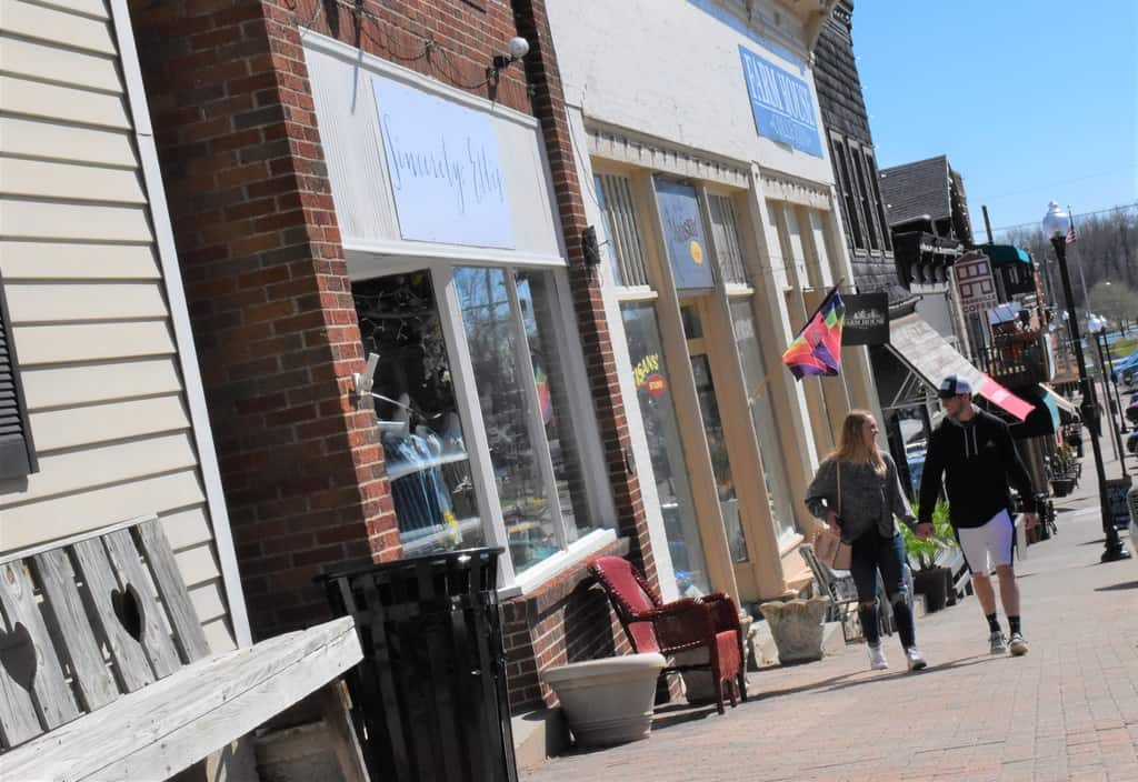 A couple explore the downtown shops in Parkville, Missouri.