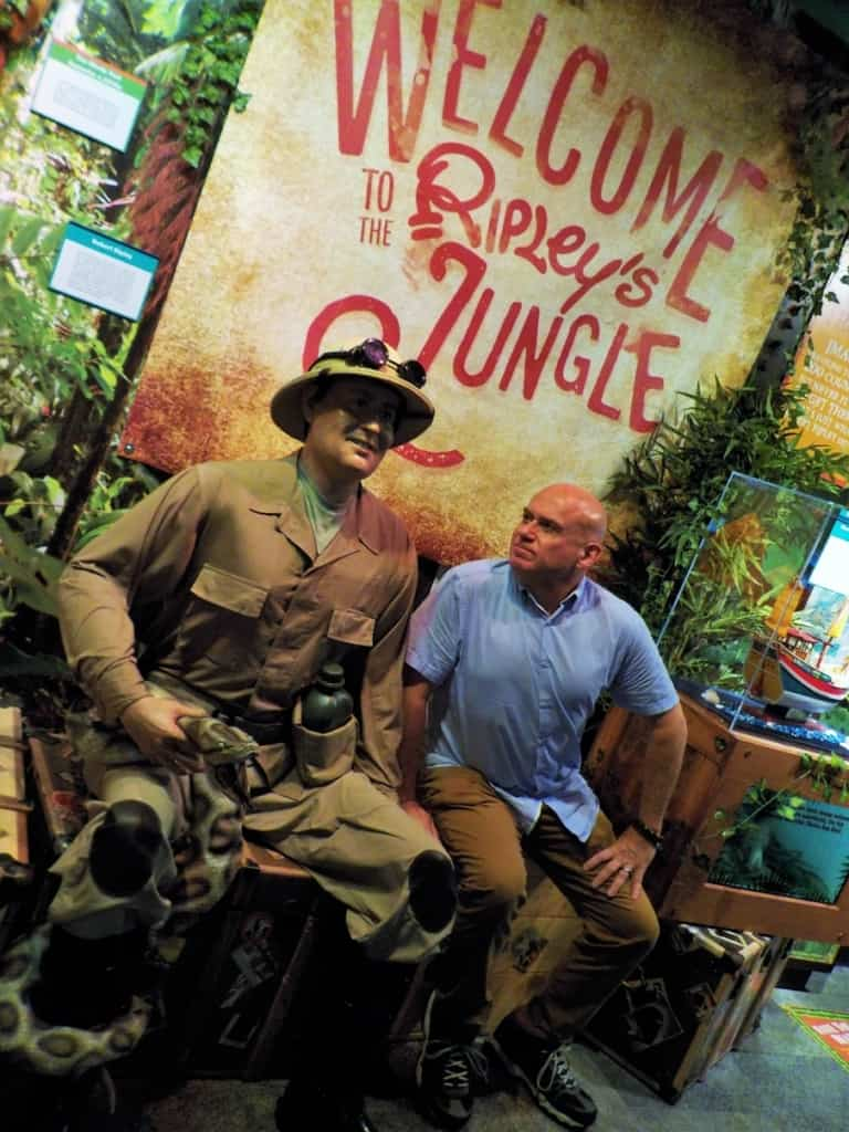 The author checks out a statue of Robert Ripley at the Gatlinburg location of Ripley's Believe It or Not!