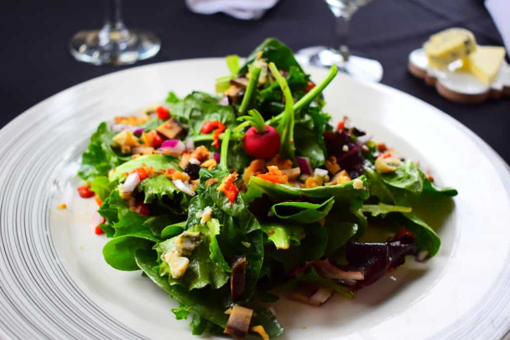 Even a house salad shows signs of refined elegance at Cafe des Amis.