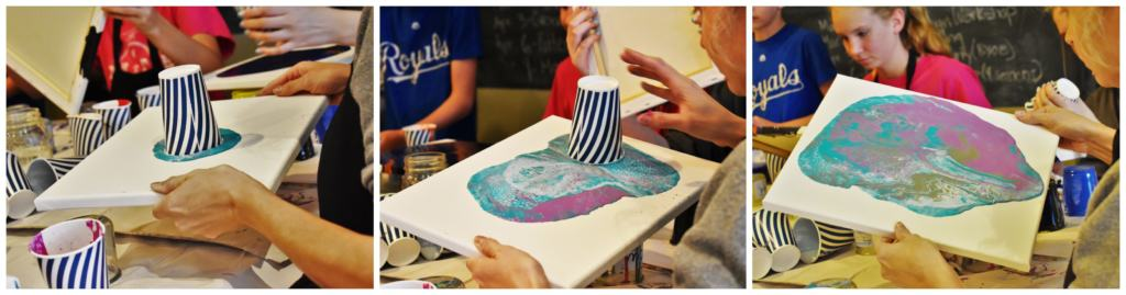A student creates their own masterpiece with poured paint and a canvas.