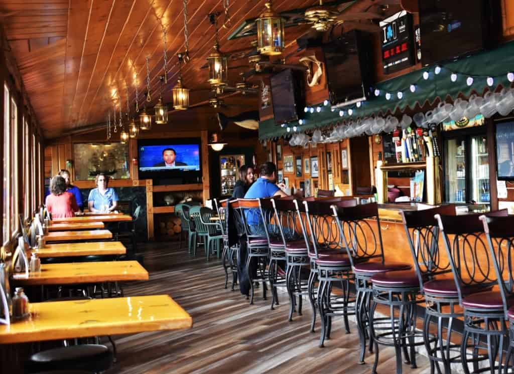 The interior of Boat House Pub is filled with a fun nautical themed decor.