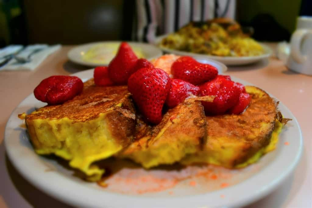 A plate of Homemade French Toast offers plenty of delectable bites to satisfy almost any hunger.