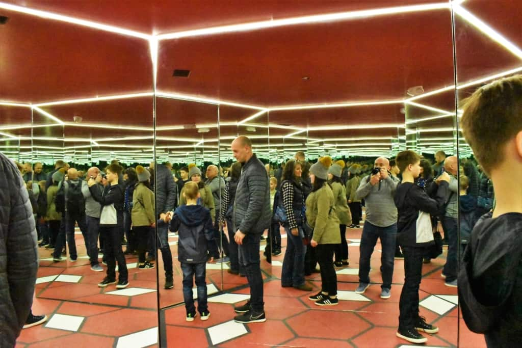 Step into the mirror room and suddenly you feel like you are in a crowd.